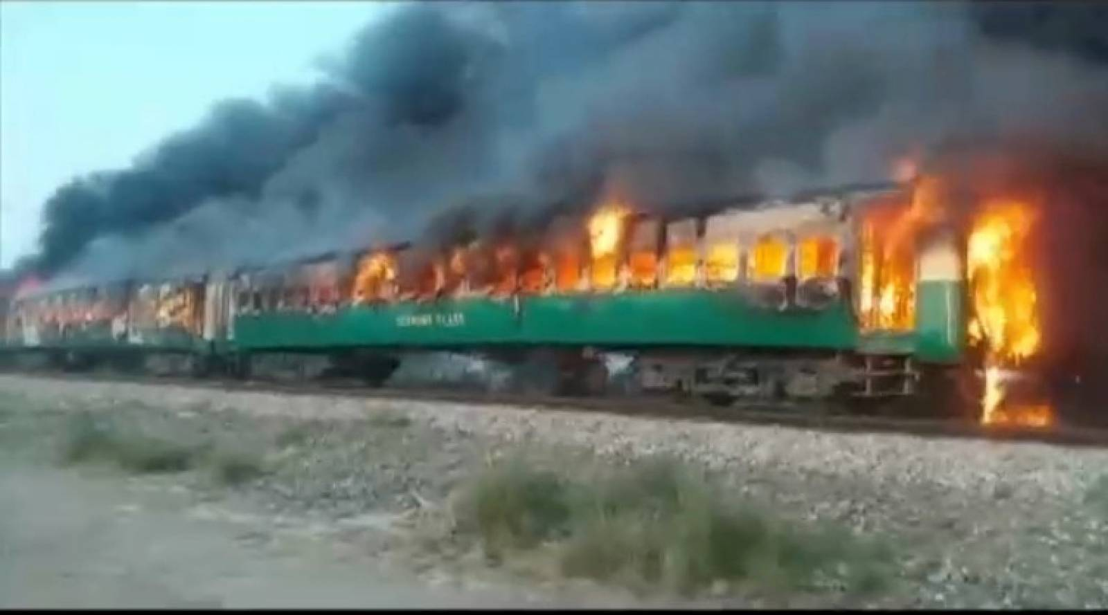 Video grab of a fire burning in a train carriage after a gas canister passengers were using to cook breakfast exploded, near the town of Rahim Yar Khan