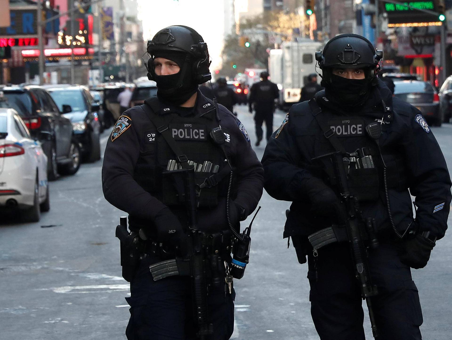 Police officers stand on a closed West 42nd Street near the New York Port Authority Bus Terminal after reports of an explosion in New York City