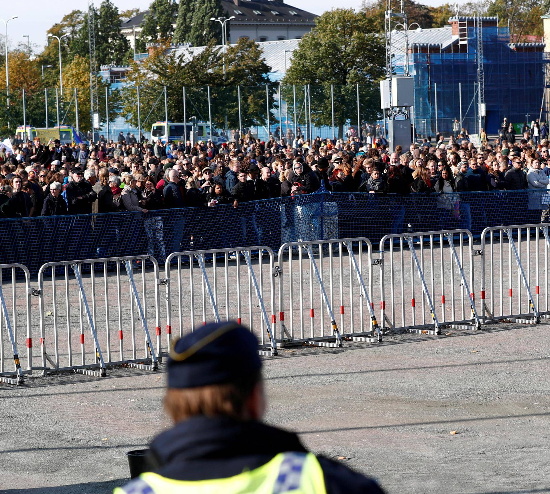 Police officers stand guard near counter-demonstrators prior to the Nordic Resistance Movement's (NMR) march in central Gothenburg, Sweden