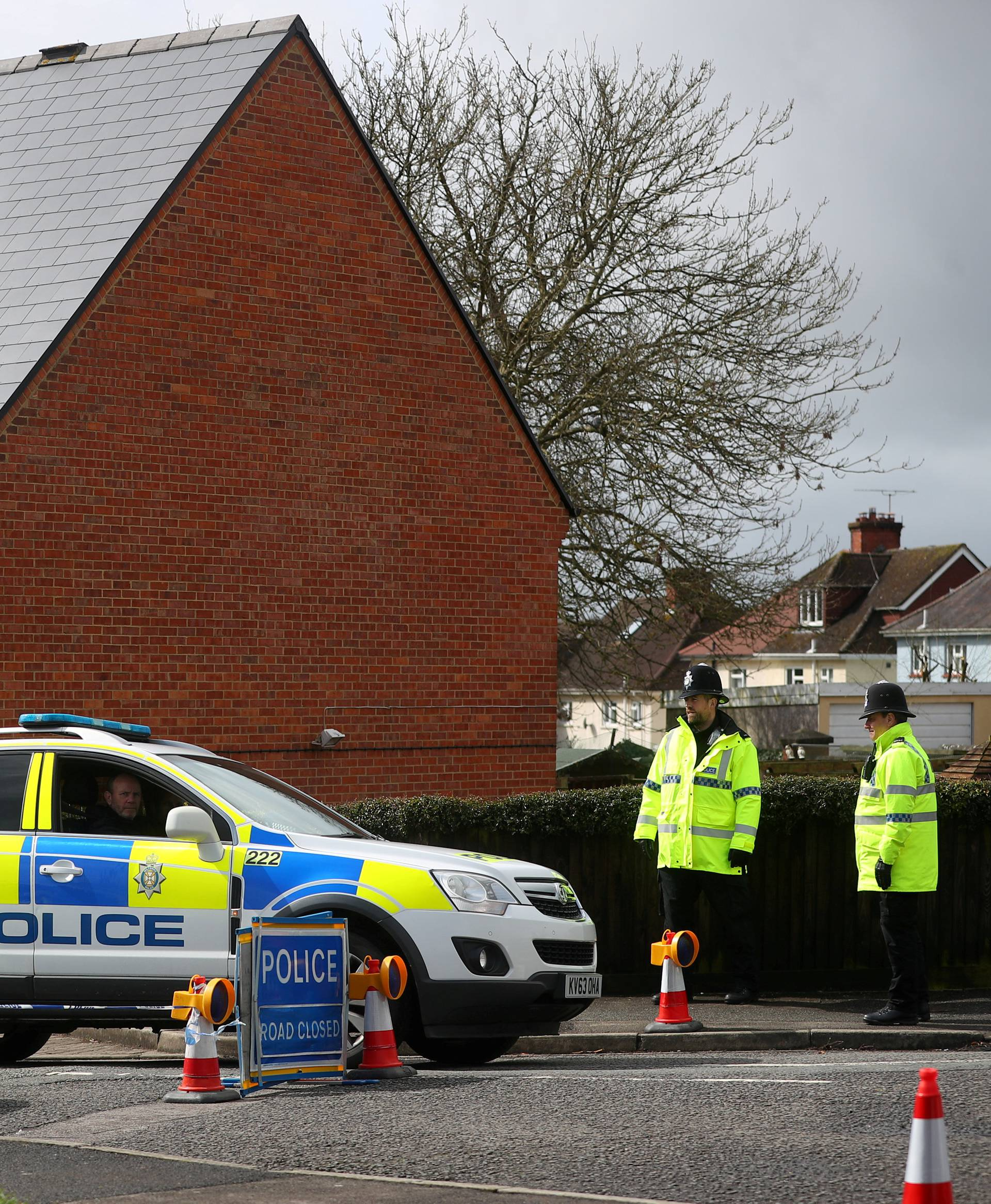 FILE PHOTO: Police officers guard the cordoned off area around the home of former Russian intelligence officer Sergei Skripal in Salisbury
