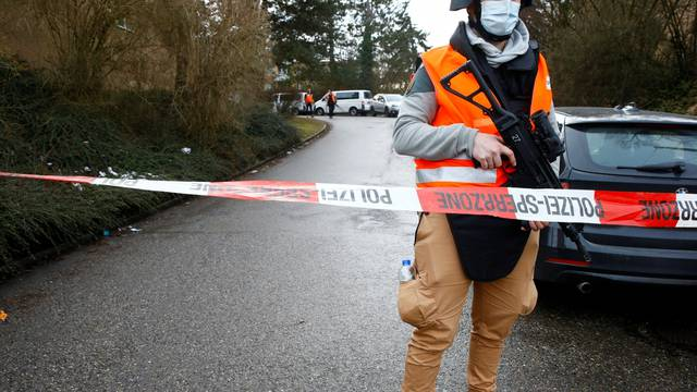 Swiss police officer stands guard near a crime scene in Winterthur