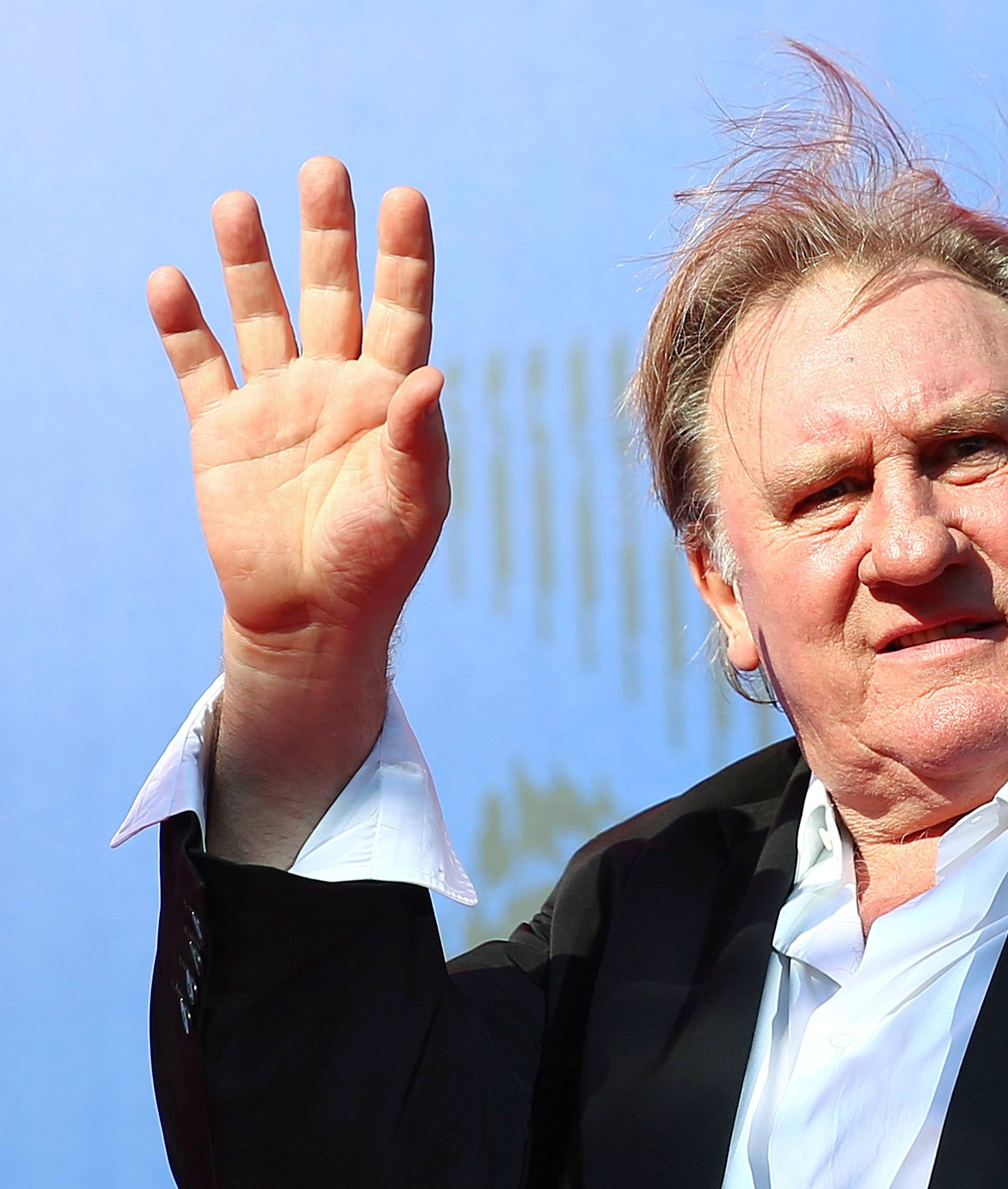 "FILE PHOTO: Gerard Depardieu waves as he arrives during a red carpet event for the movie ""Novecento- Atto Primo"" at the 74th Venice Film Festival in Venice"