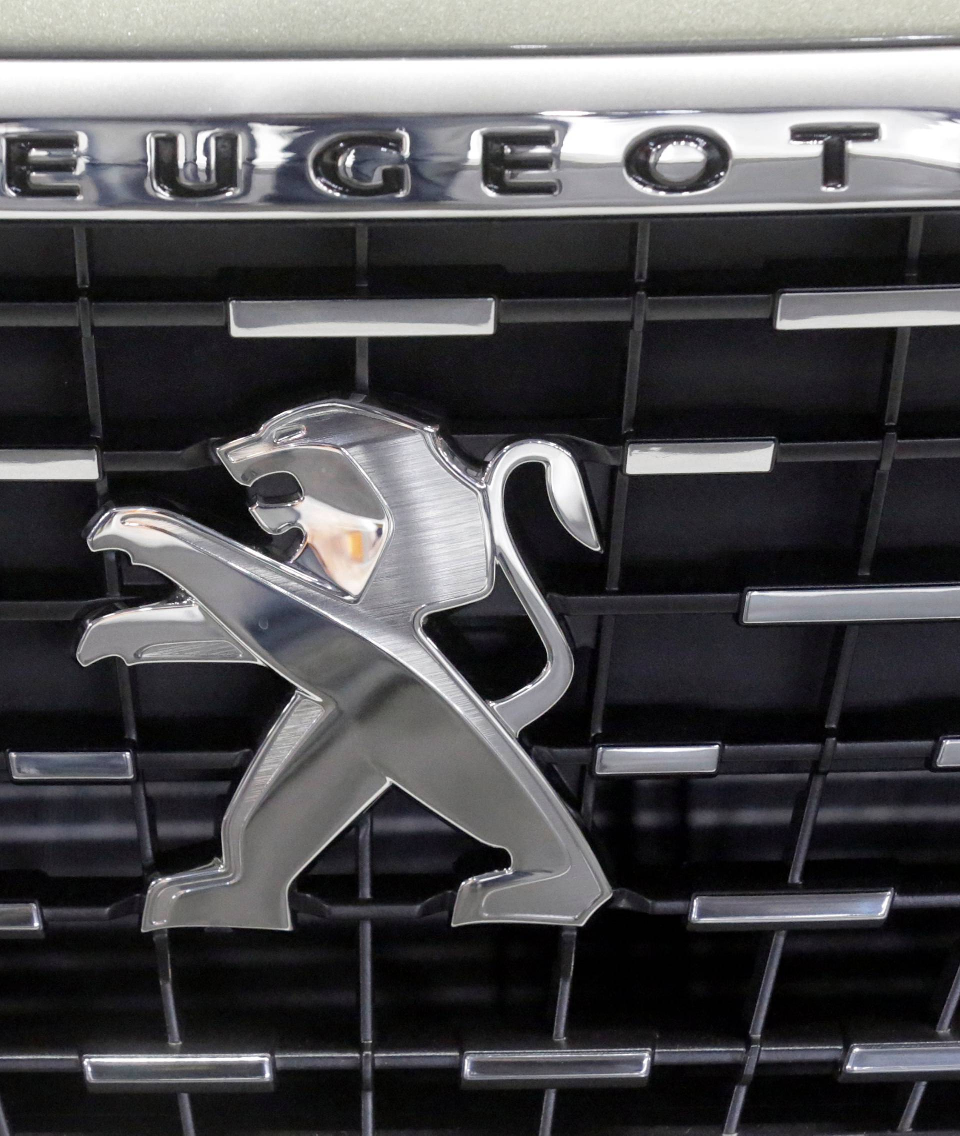 A logo of Peugeot car is seen during International Motor Show in Riga