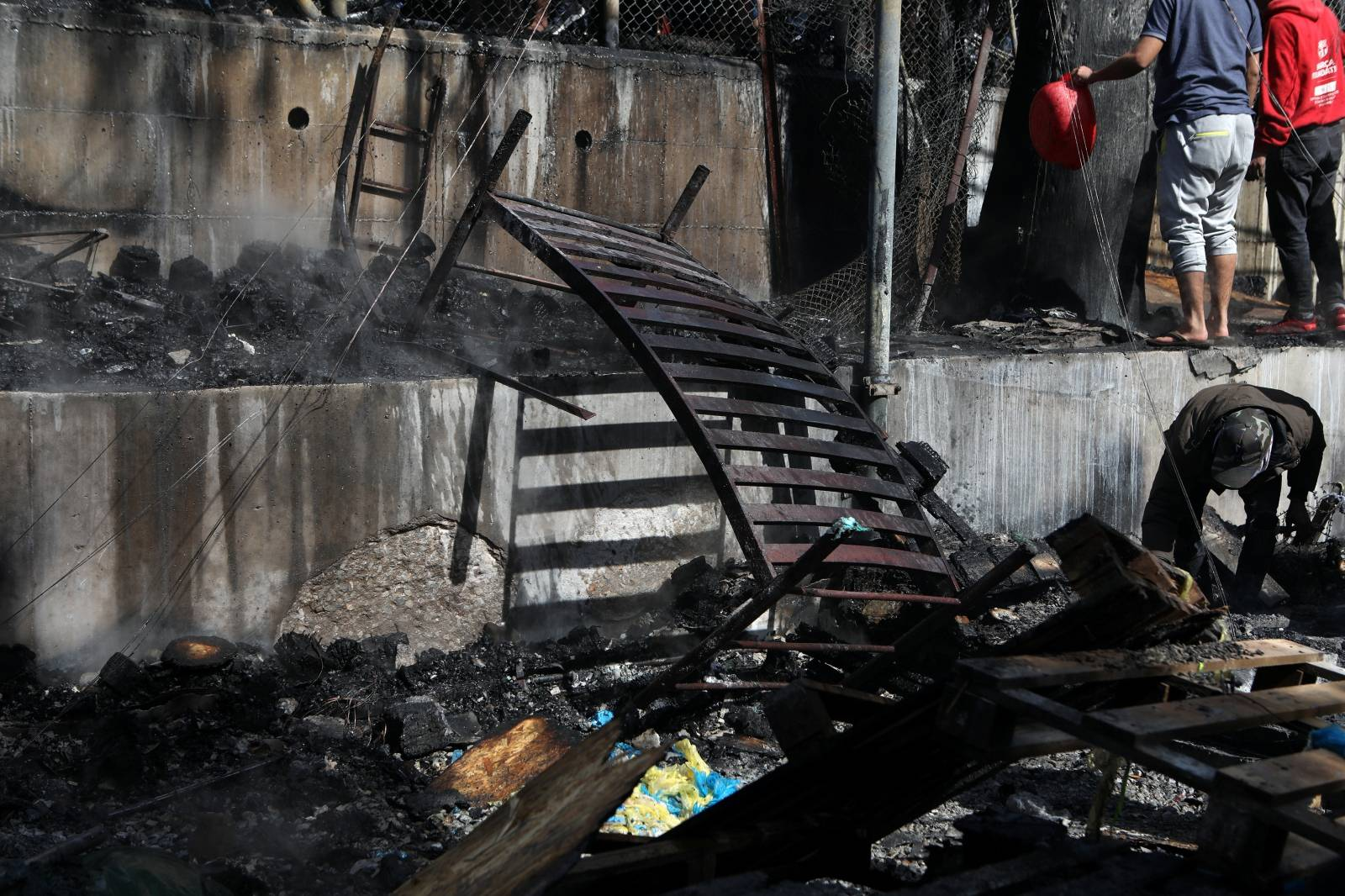 A burnt bed is seen following a fire in containers used to house refugees and migrants in the Moria camp on the island of Lesbos