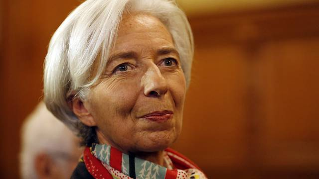 FILE PHOTO : Managing Director of the International Monetary Fund Christine Lagarde reacts before the start of her trial about a state payout in 2008 to a French businessman, at the courts in Paris