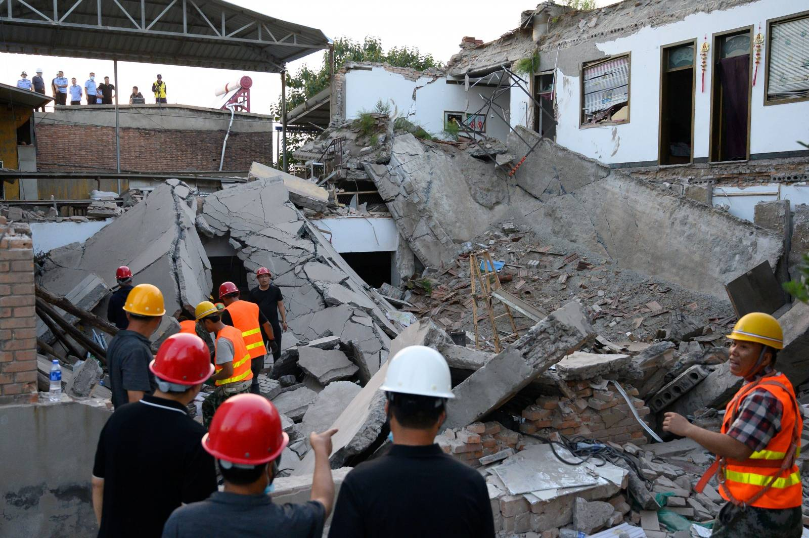 Rescue workers are seen at the site where a restaurant collapsed, in Xiangfen