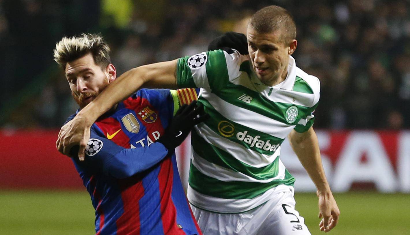 Celtic's Jozo Simunovic in action with Barcelona's Lionel Messi