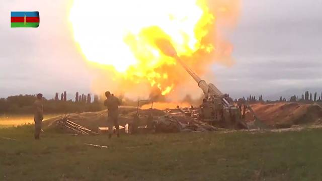 A still image shows members of Azeri armed forces firing artillery in an unidentified location