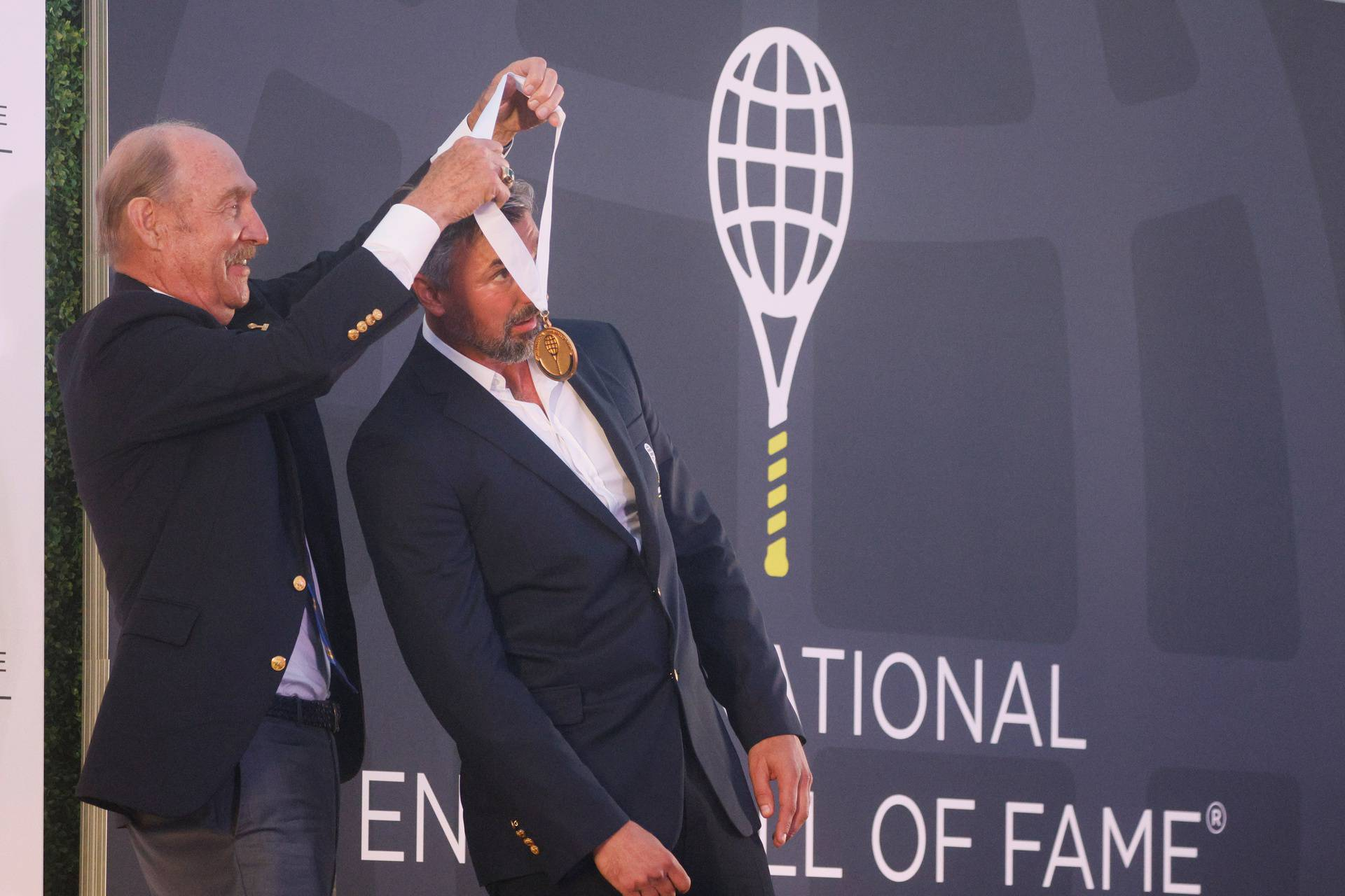 Goran Ivanisevic of Croatia is inducted into the International Tennis Hall of Fame in Newport