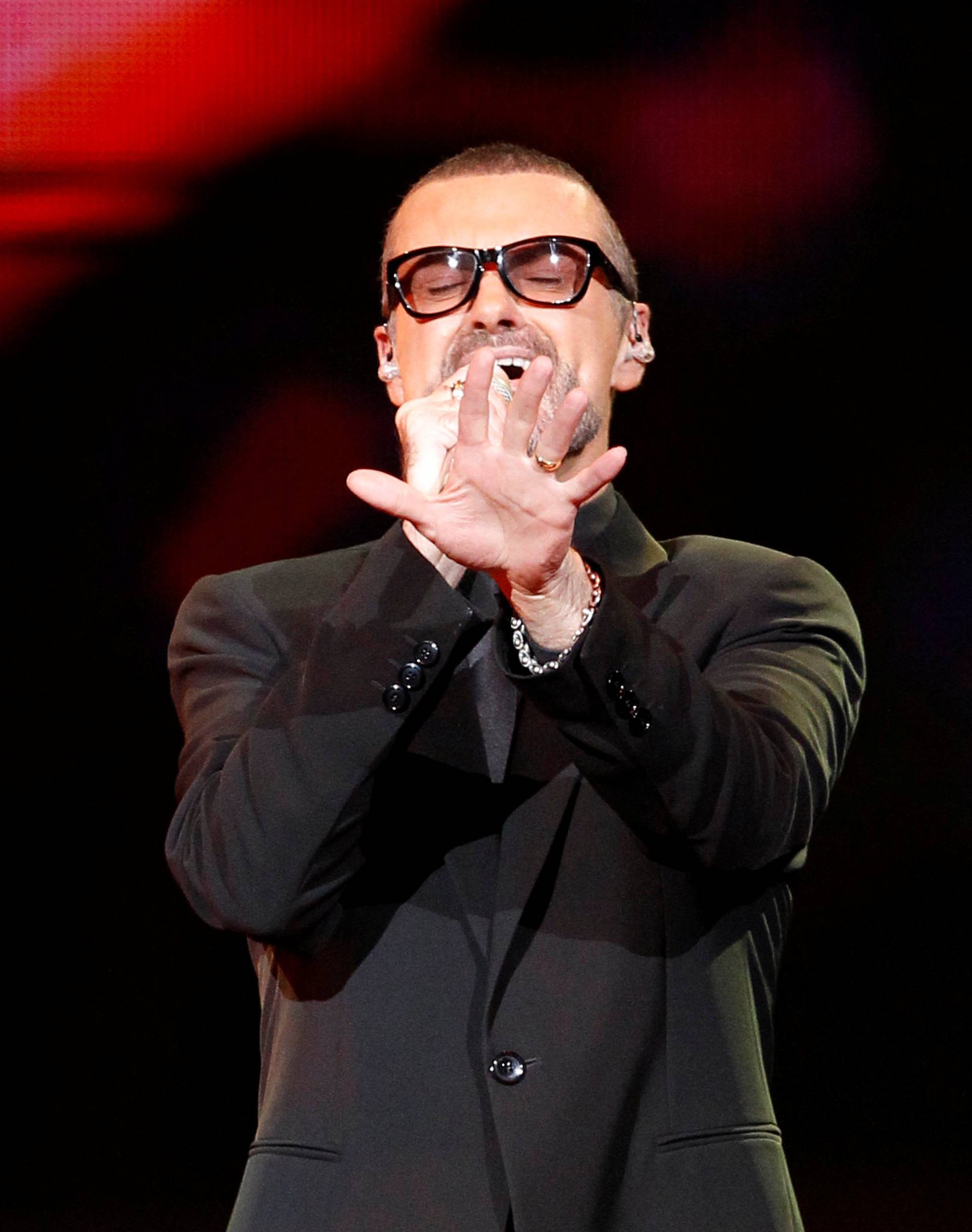 """FILE PHOTO British singer George Michael performs on stage during his """"Symphonica"""" tour concert in Berlin"""