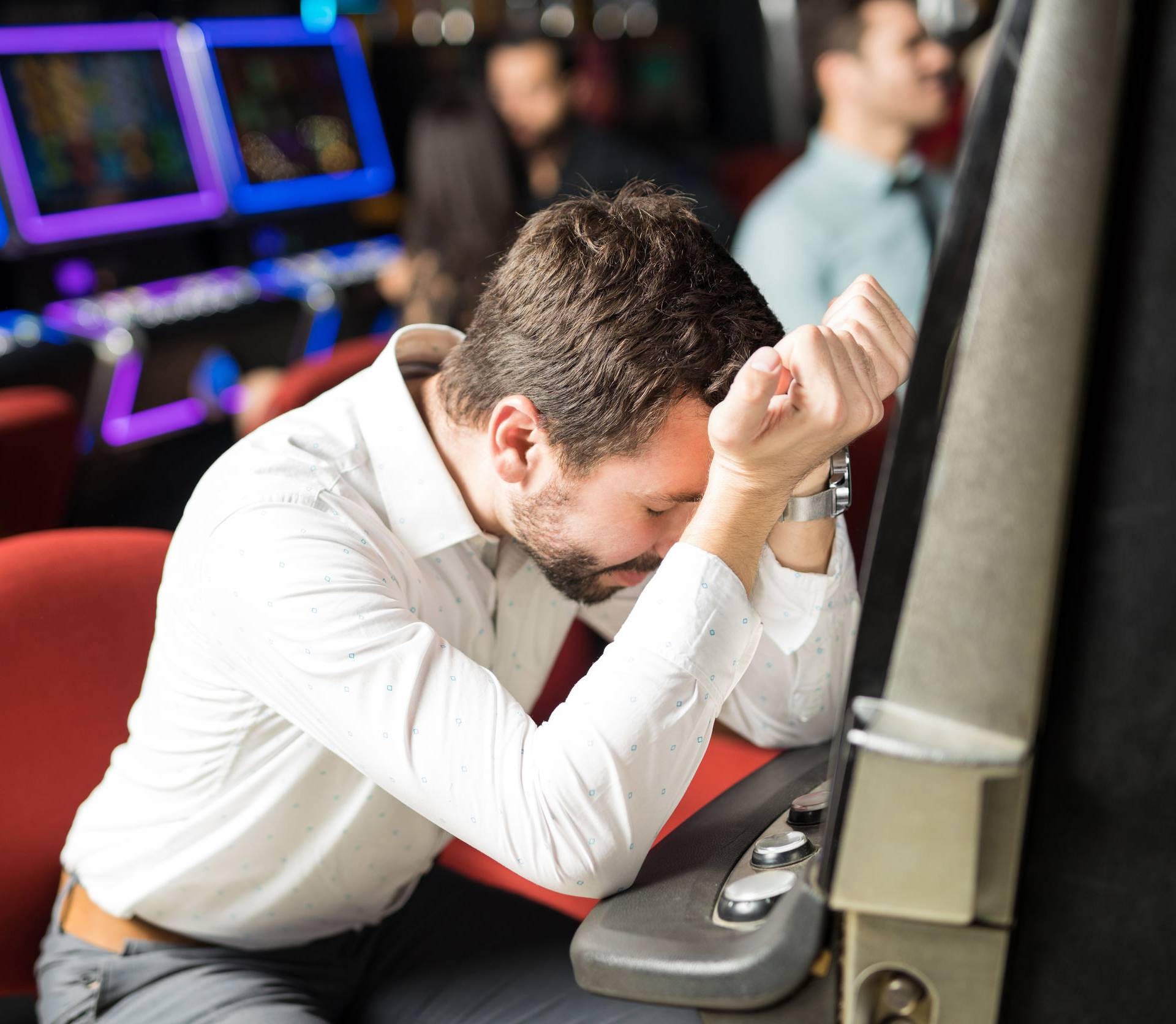 Stressed man losing money in a casino