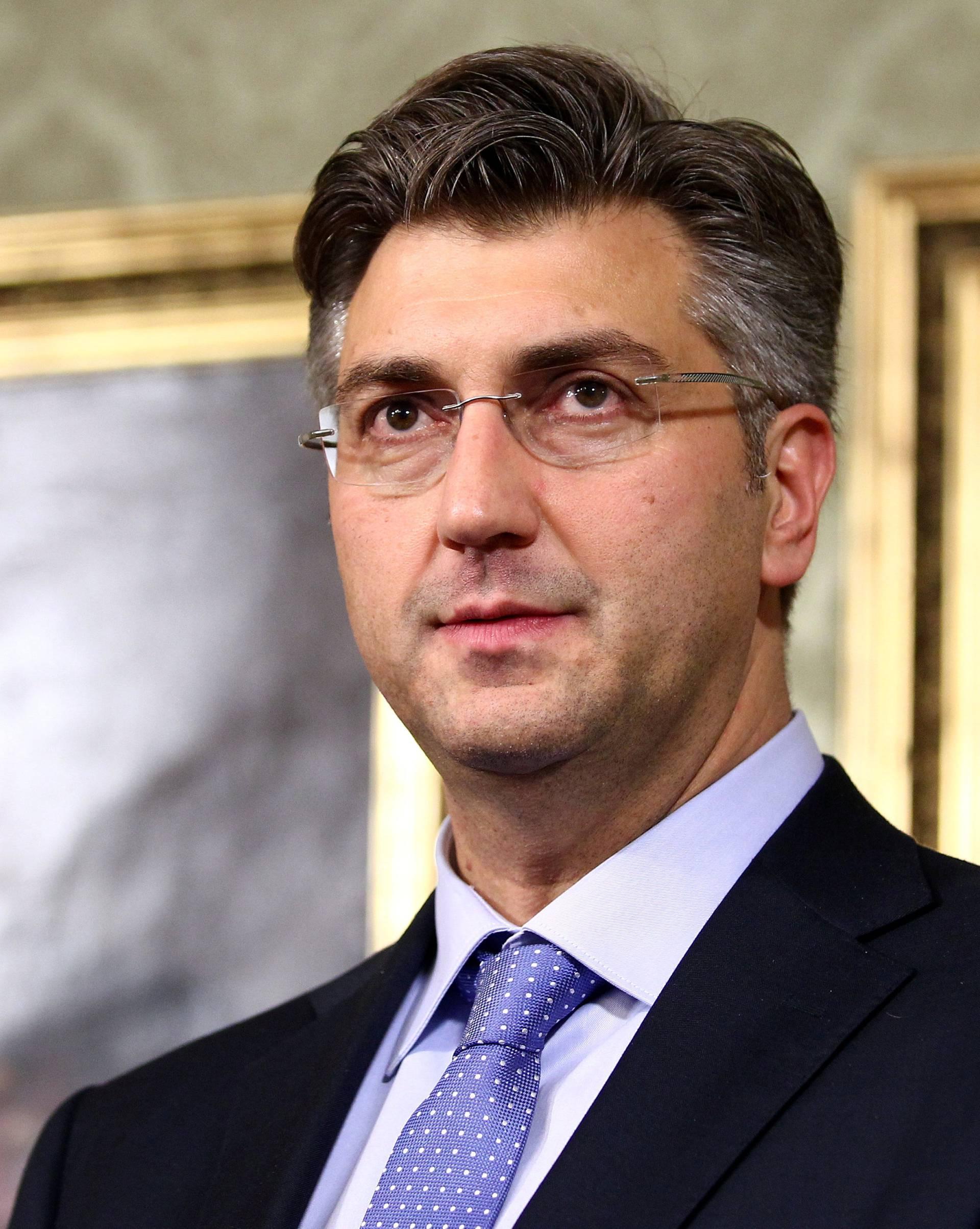Croatia's new Prime Minister Andrej Plenkovic speaks in government buillding in Zagreb