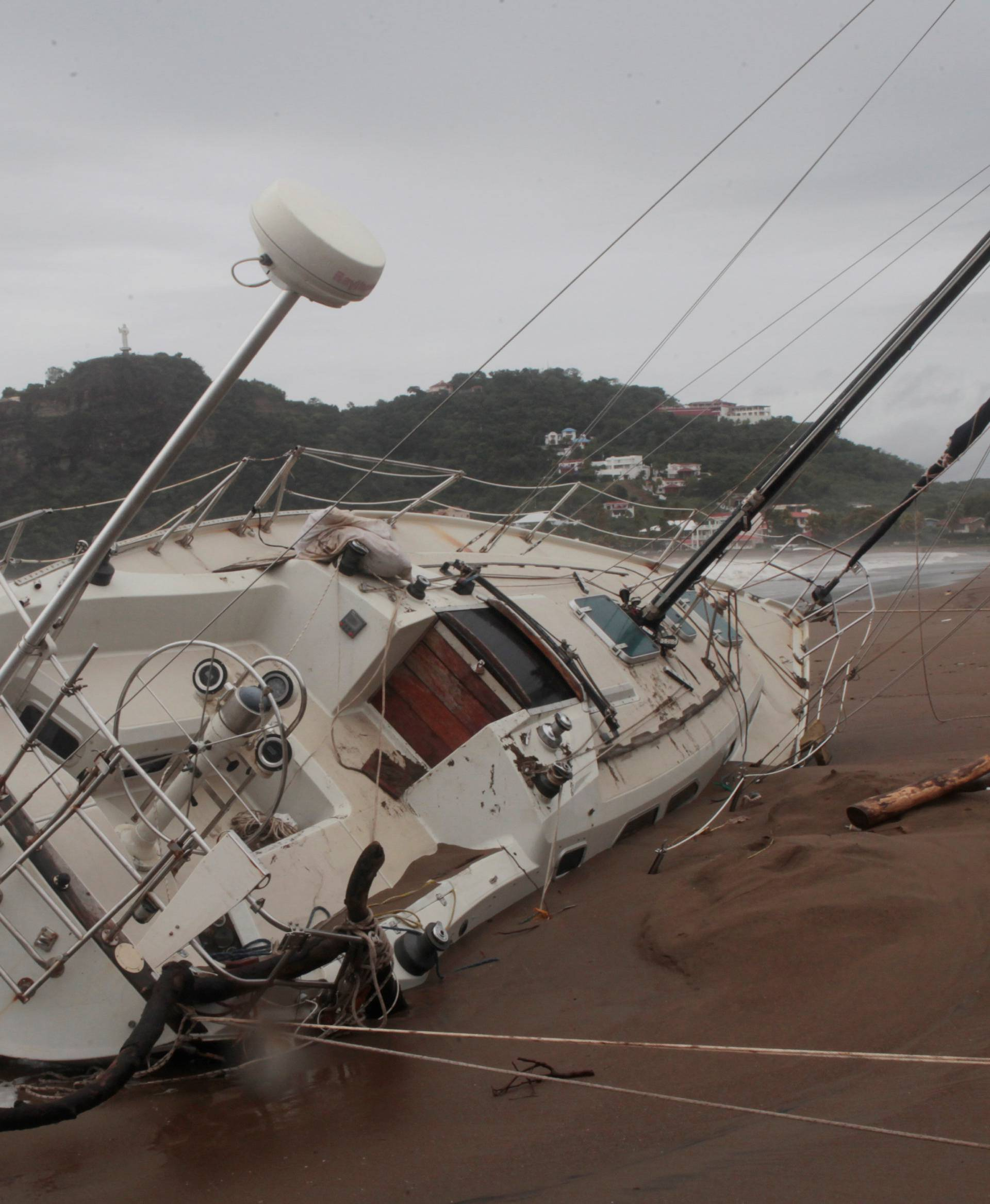 A damaged boat is pictured on the shore of  San Juan del Sur Bay