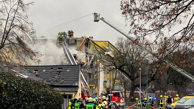 Rescue workers are seen at the site of an explosion of a house in Langenzersdorf