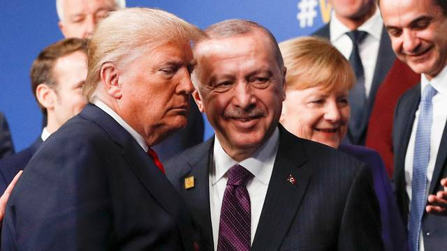 FILE PHOTO: U.S. President Donald Trump and Turkish President Recep Tayyip Erdogan leave the stage after a family photo during the NATO NATO summit in Watford, Britain