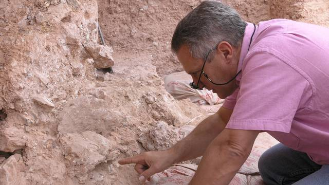 Dr. Jean-Jacques Hublin points out the new finds at Jebel Irhoud in Morocco in this handout photo