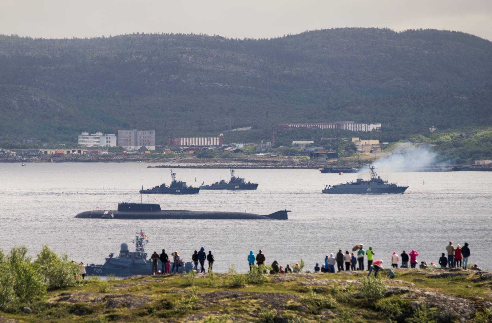 Russian navy ships and a submarine take part in a naval parade at the port of Severomorsk