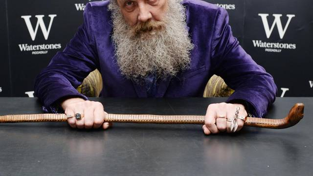 Alan Moore signs copies of his book 'Fashion Beast'