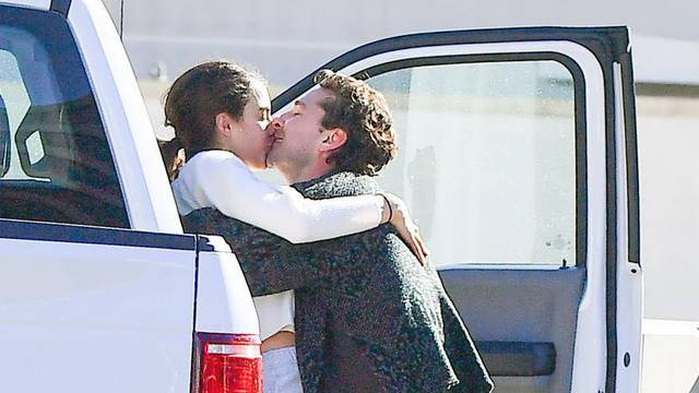 *PREMIUM EXCLUSIVE NO WEB UNTIL 3PM EST 21ST DEC* New Couple Alert!! Shia LaBeouf attempts to put his recent troubles behind him as he takes part in a major PDA session with actress and model Margaret Qualley