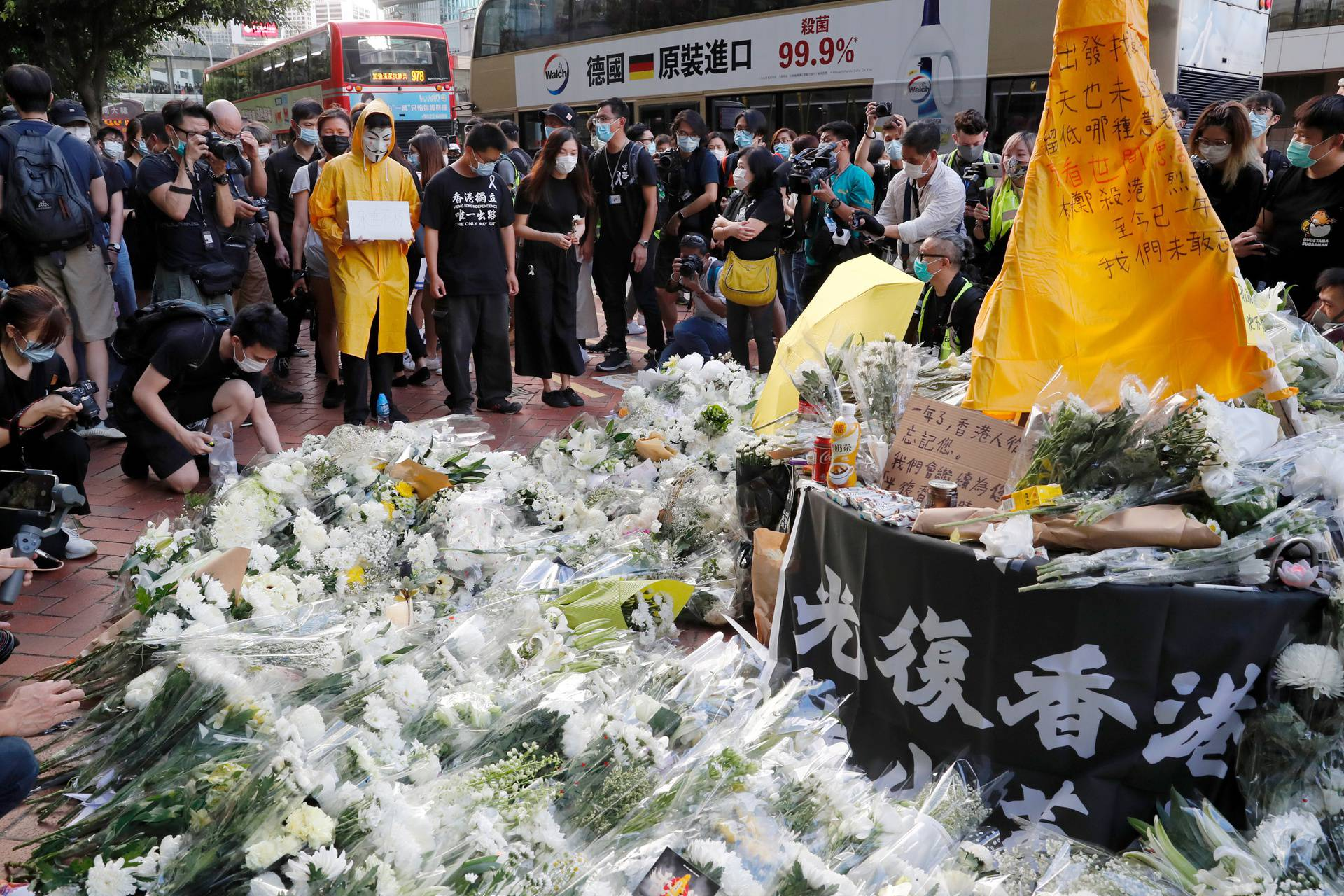 A vigil for a protester Marco Leung Ling-kit who fell to his death during a demonstration outside the Pacific Place mall a year ago, in Hong Kong