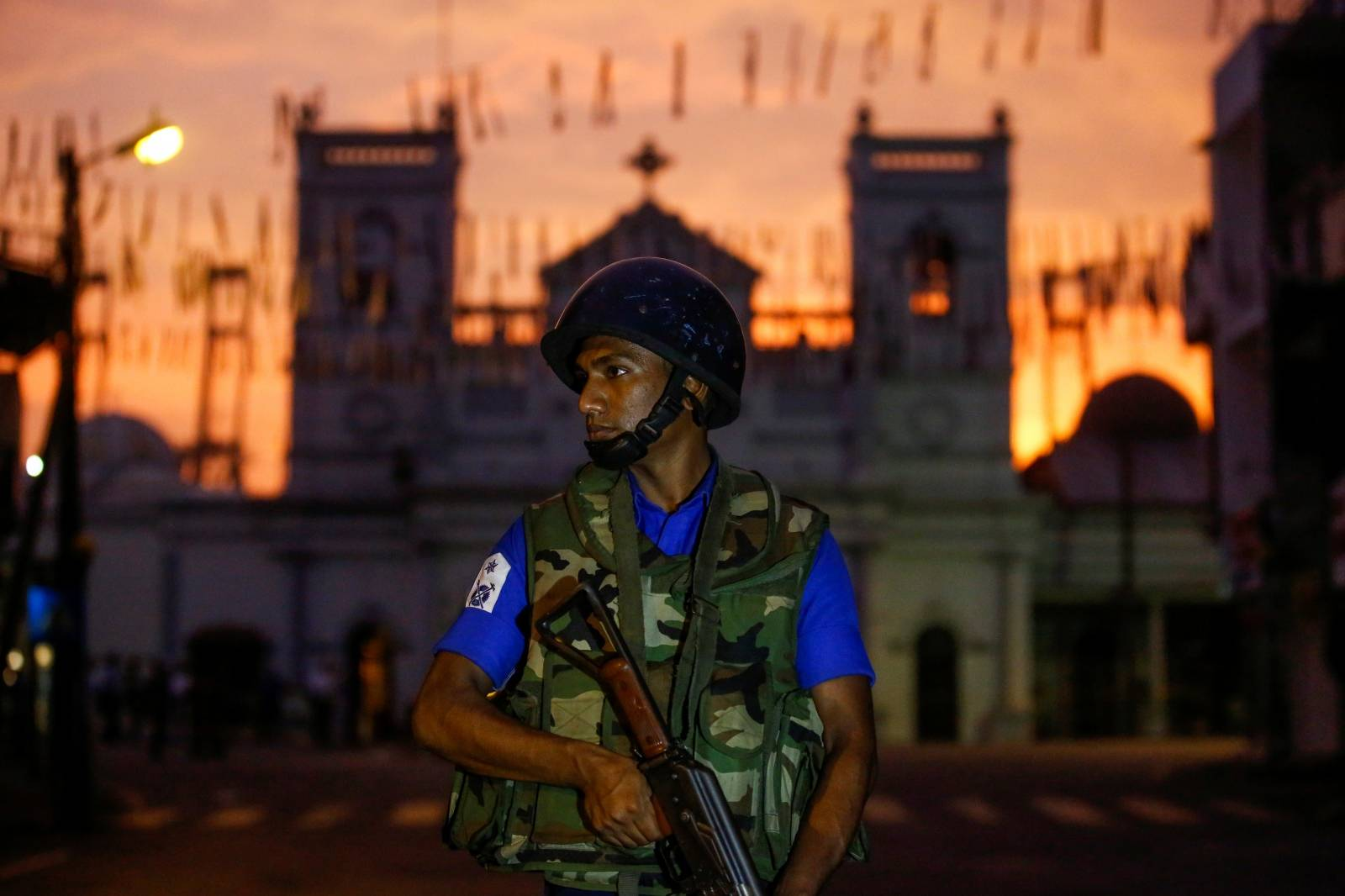 A security officer stands guard outside St. Antony's Shrine in Colombo