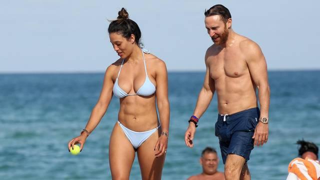 French DJ David Guetta and model girlfriend Jessica Ledon show off their beach bodies in Miami Beach