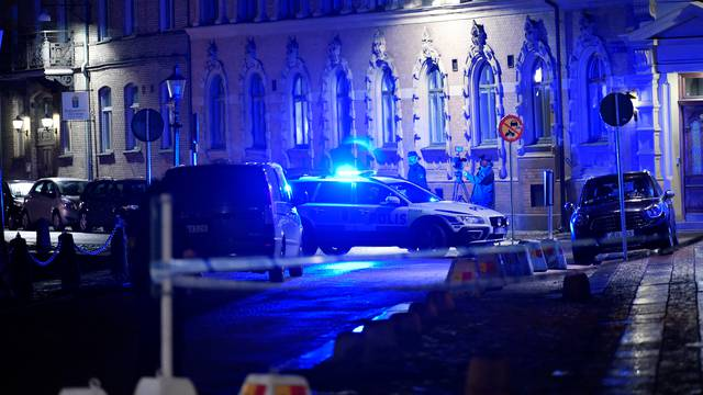 Police is seen at the site of an attack near a synagogue in Gothenburg