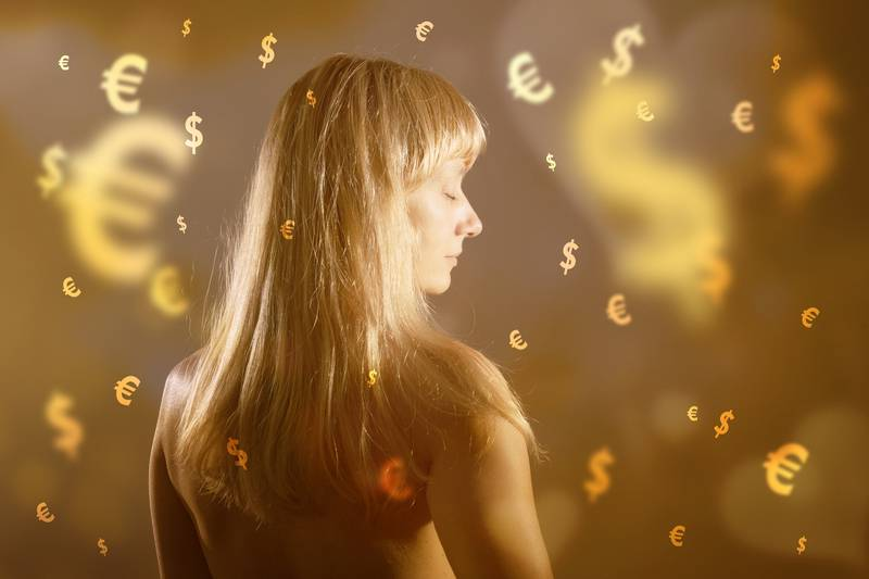 Blonde woman dreaming about money