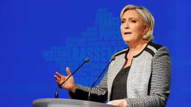 French politician Marine Le Pen delivers a speech to announce the new name of the far-right National Front political party, that becomes the National Rally (Rassemblement National) party, during a national council in Bron