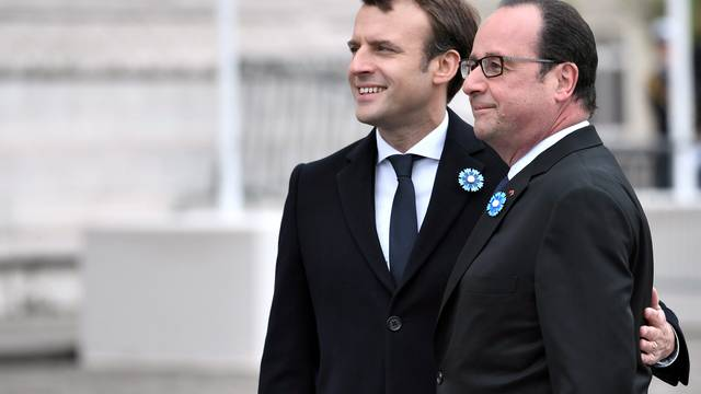 Outgoing French President Hollande and President-elect Macron attend a ceremony to mark the end of World War II at the Tomb of the Unknown Soldier at the Arc de Triomphe in Paris
