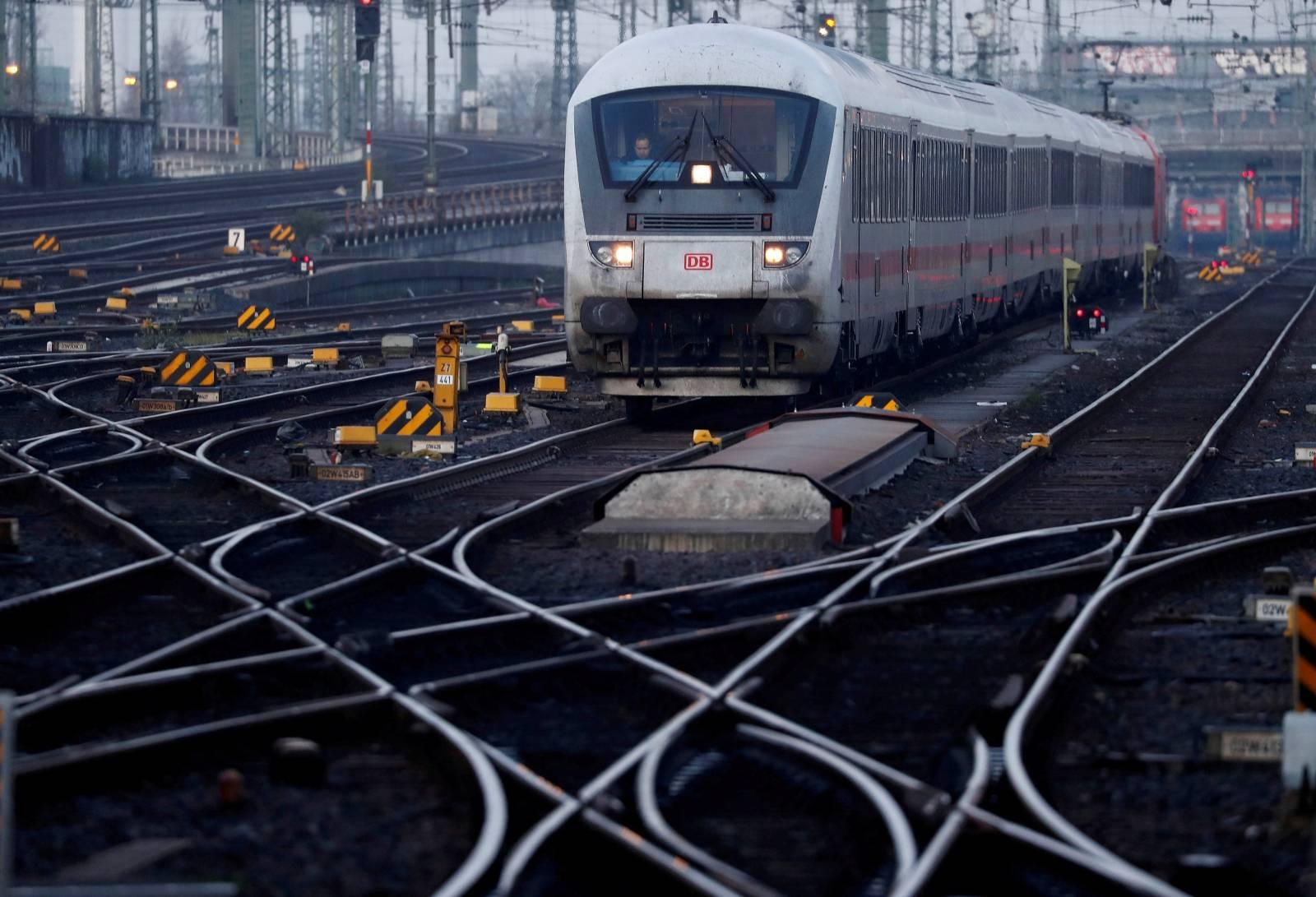 FILE PHOTO: A locomotive engine of German railway Deutsche Bahn is seen at the main train station in Frankfurt