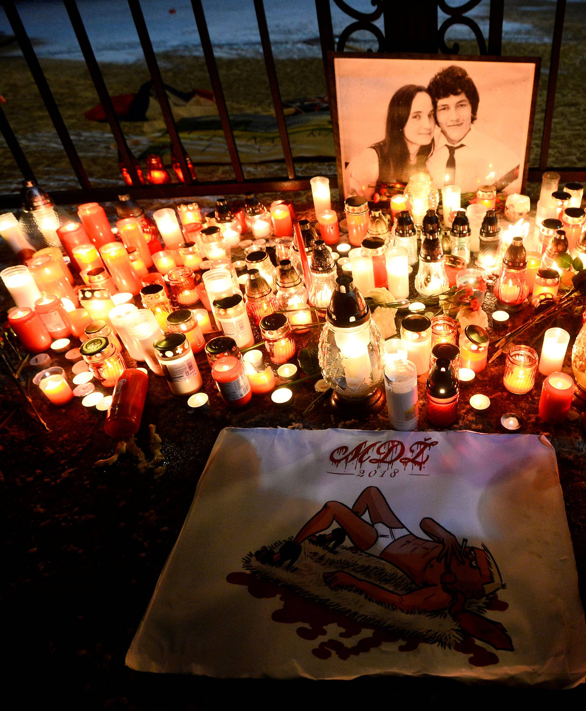 Candles are seen in front of the Government of the Slovak Republic's building during march in honour of murdered Slovak investigative reporter Jan Kuciak in Bratislava