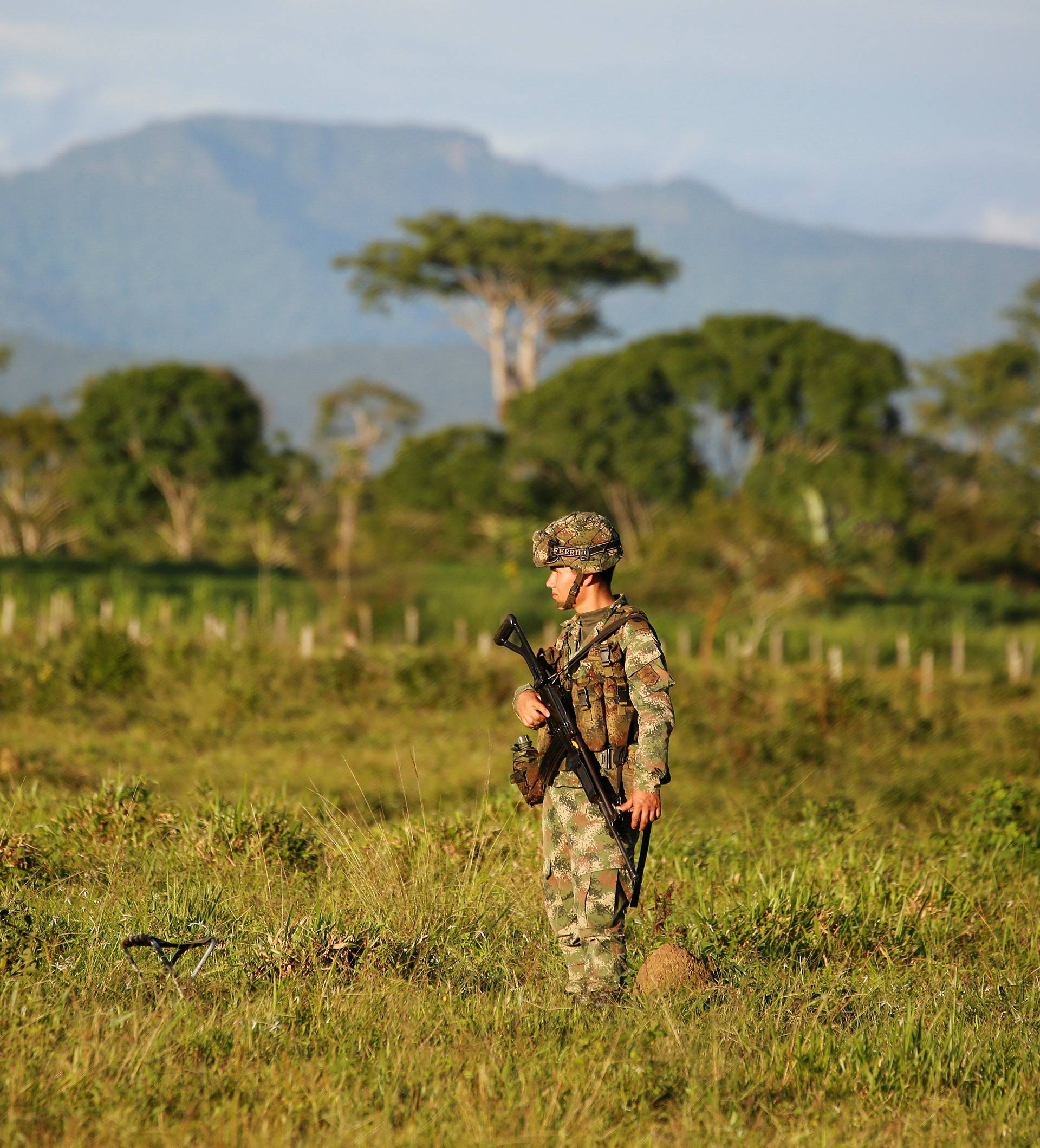 A soldier of the Military Forces of Colombia, stands guard during the army's arrival to an area that was previously occupied by FARC rebels, in Meta
