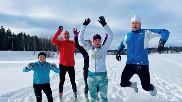 Athletes jump in the snow as they wear woollen socks instead of footwear during their training in Espoo