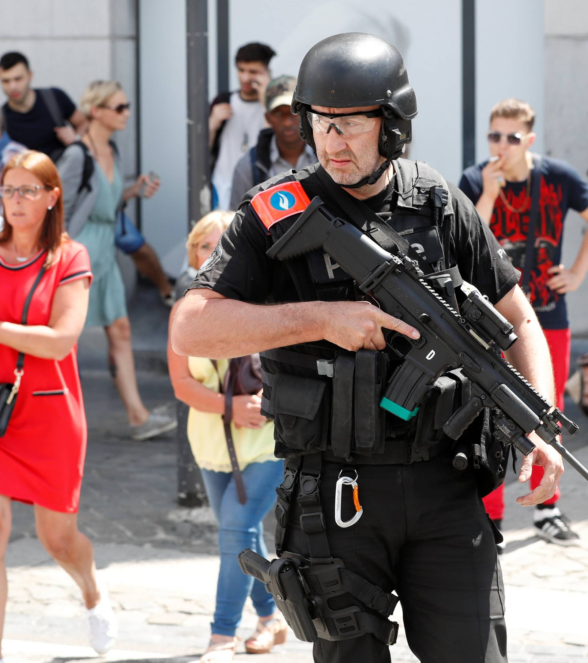 A member of the special police forces gestures in Liege