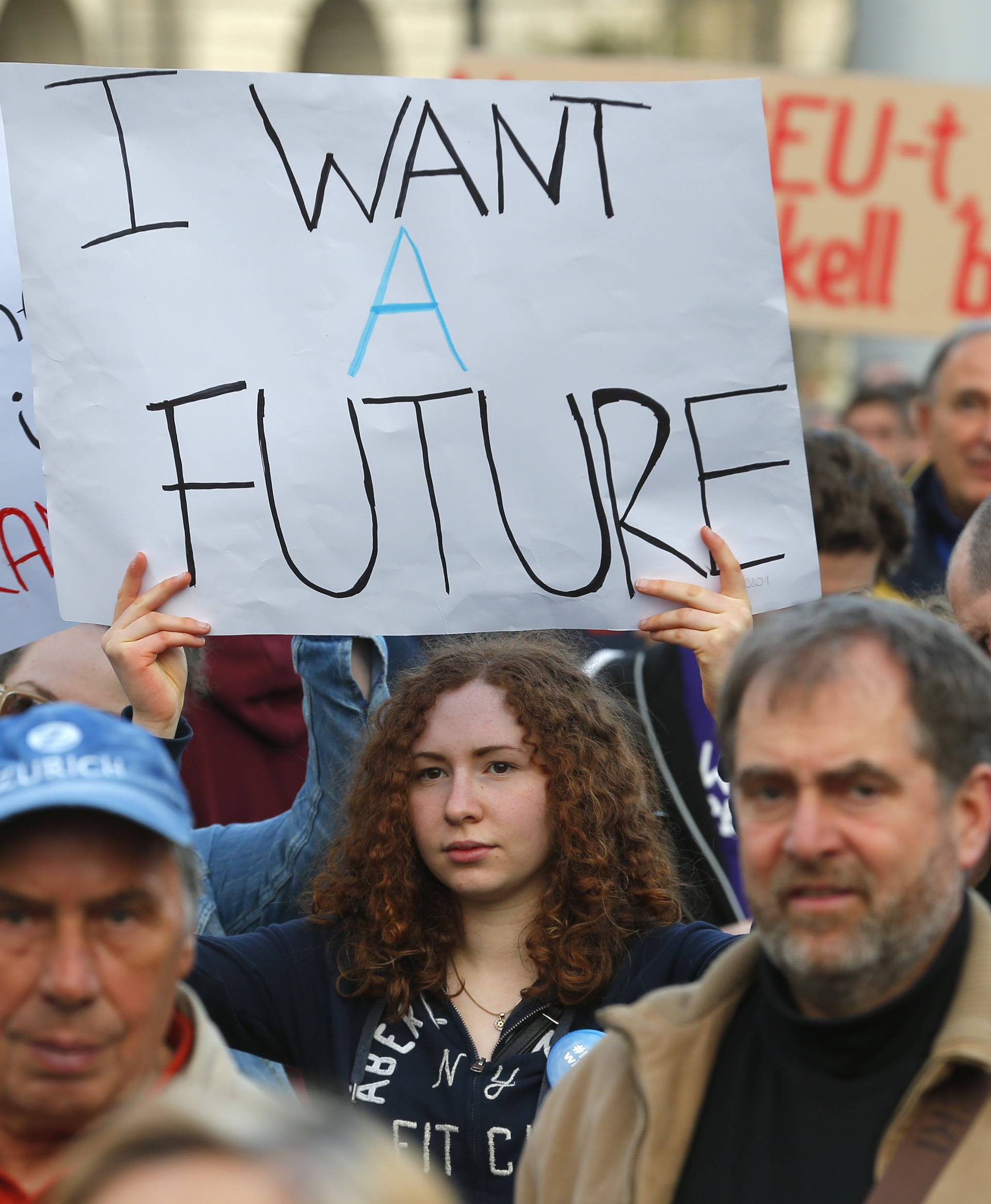 People hold placards as they protest against the bill that would undermine Central European University in Budapest
