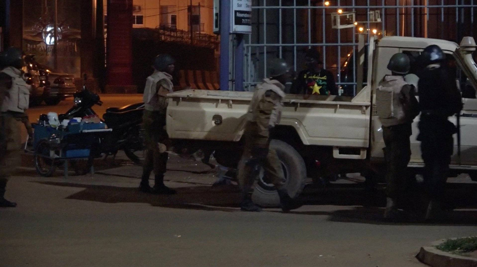 Soldiers are seen at the back of a truck following an attack by gunmen on a restaurant in Ouagadougou, Burkina Faso, in this still frame taken from video