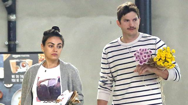 EXCLUSIVE: Mila Kunis and Ashton Kutcher out in Los Angeles buying some flowers