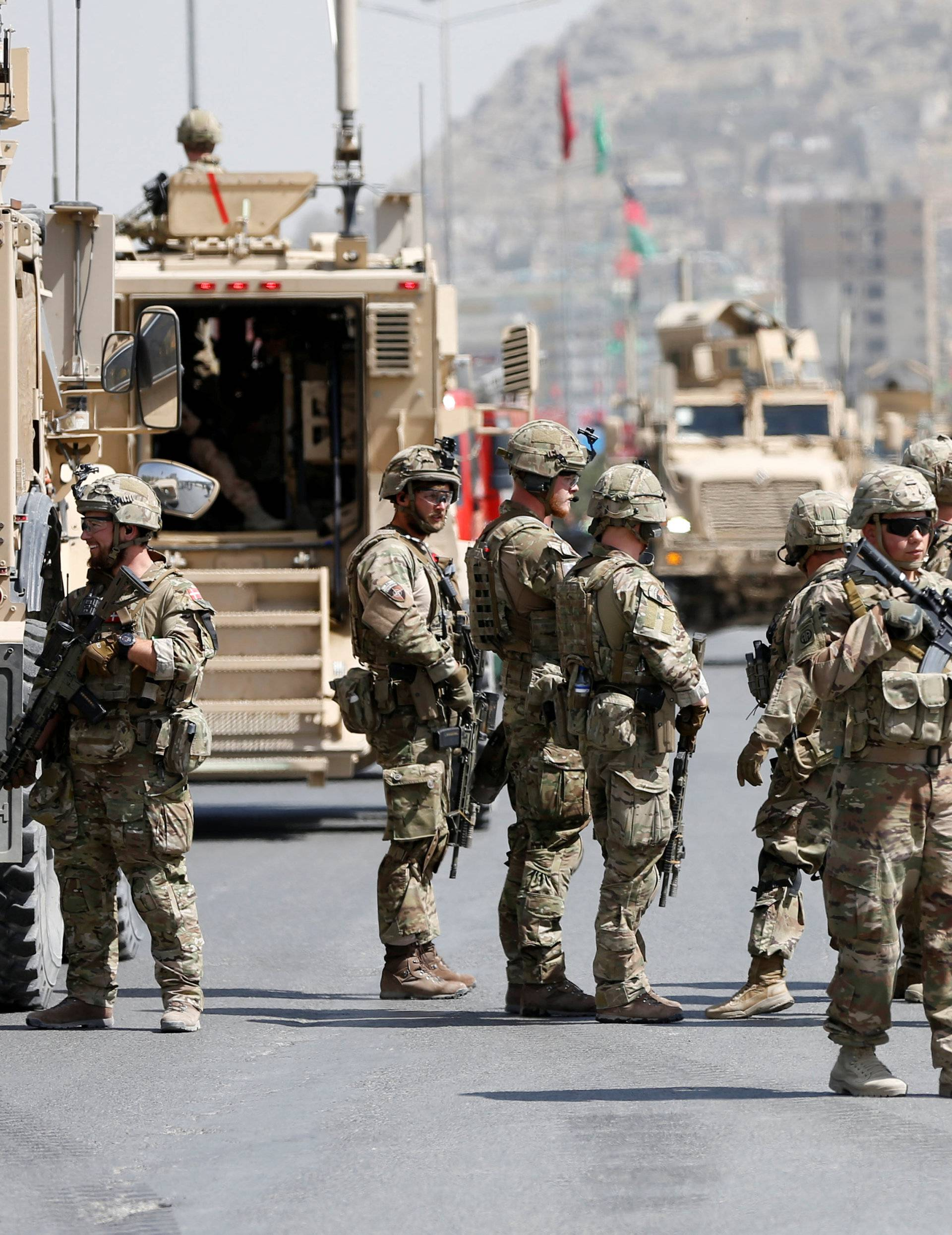 U.S. and NATO troops arrive at the site of a car bomb attack in Kabul, Afghanistan