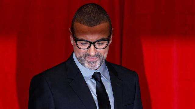 FILE PHOTO British singer George Michael poses for photographers before a news conference at the Royal Opera House in central London