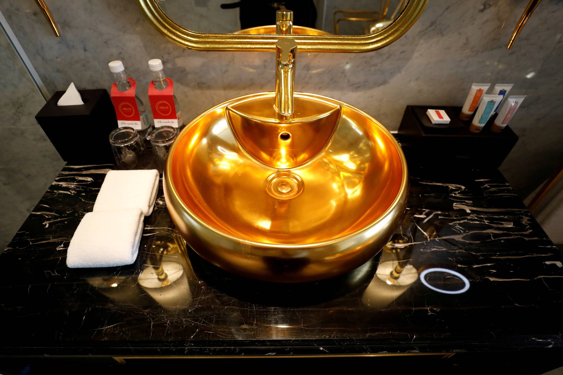 FILE PHOTO: A gold-plated bathroom sink is seen in the newly inaugurated Dolce Hanoi Golden Lake luxury hotel, after the government eased a nationwide lockdown following the global outbreak of the coronavirus disease (COVID-19), in Hanoi, Vietnam