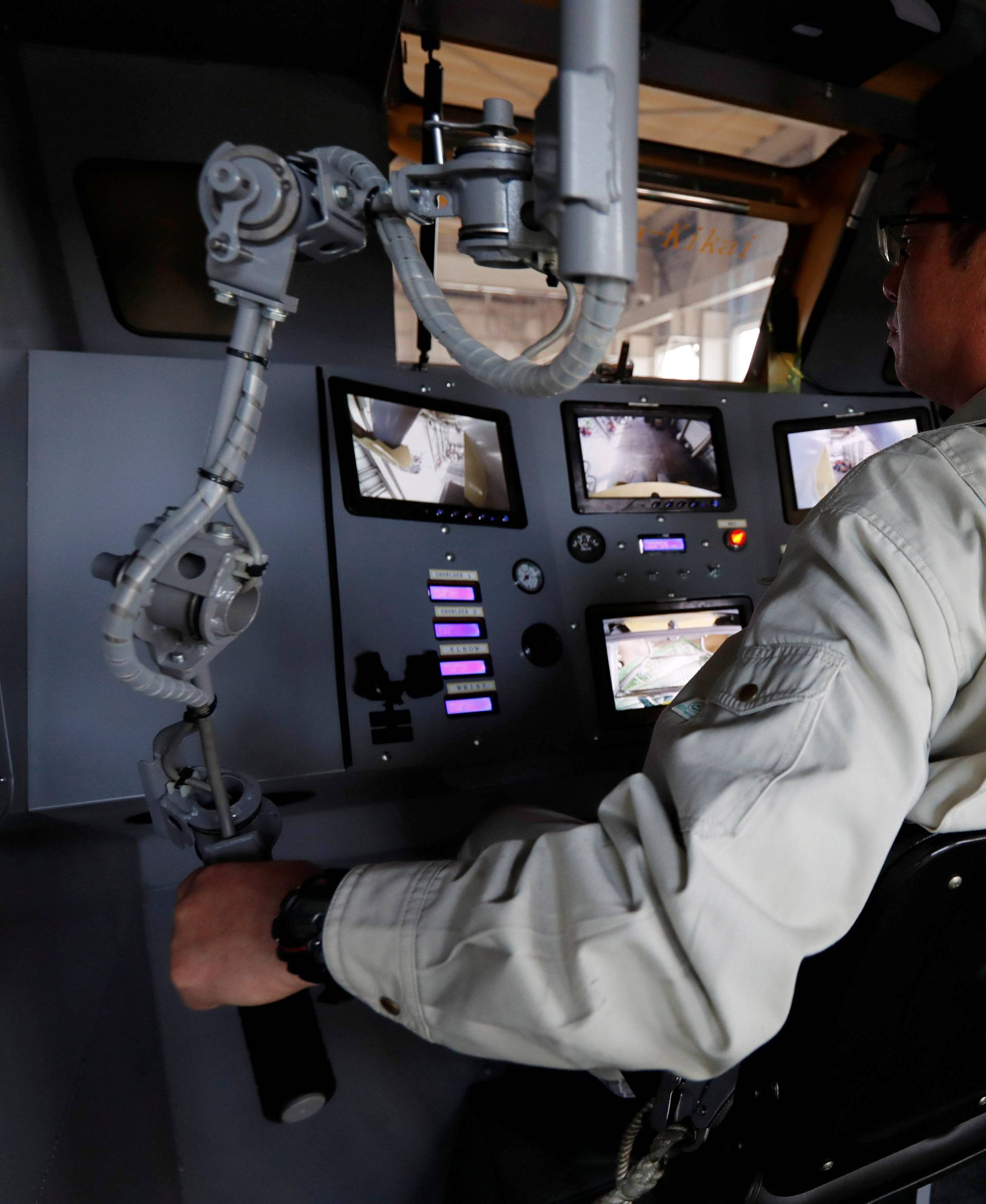 Sakakibara Kikai's engineer Masaaki Nagumo controls the bipedal robot Mononofu from its cockpit during its demonstration at its factory in Shinto Village, Gunma Prefecture