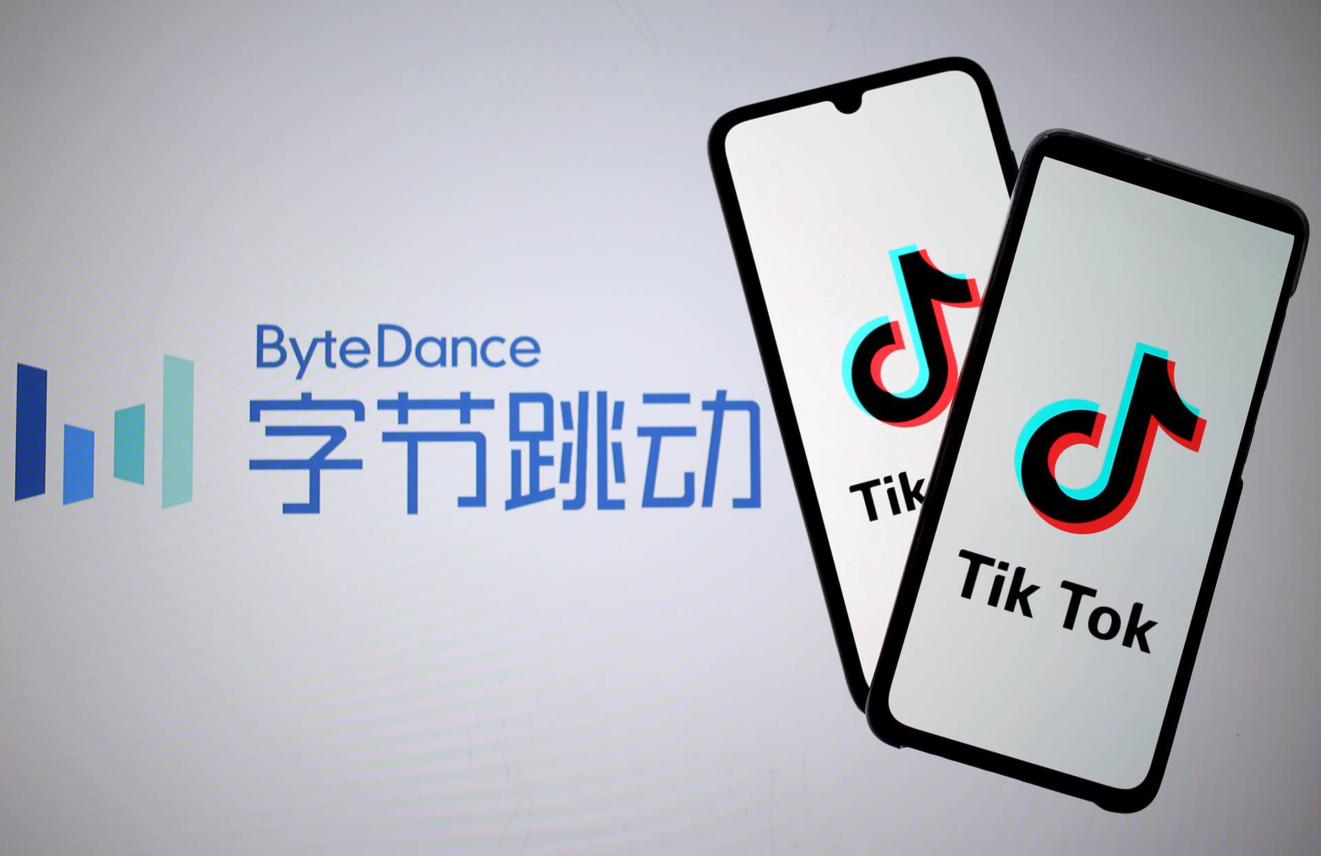 FILE PHOTO: Tik Tok logos are seen on smartphones in front of displayed ByteDance logo in this illustration