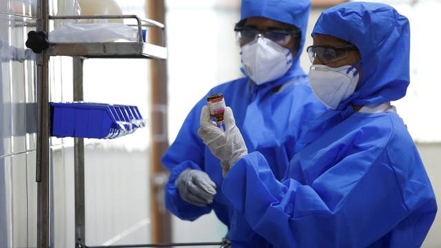 Medical staff with protective clothing are seen inside a ward specialised in receiving any person who may have been infected with coronavirus, at the Rajiv Ghandhi Government General hospital in Chennai