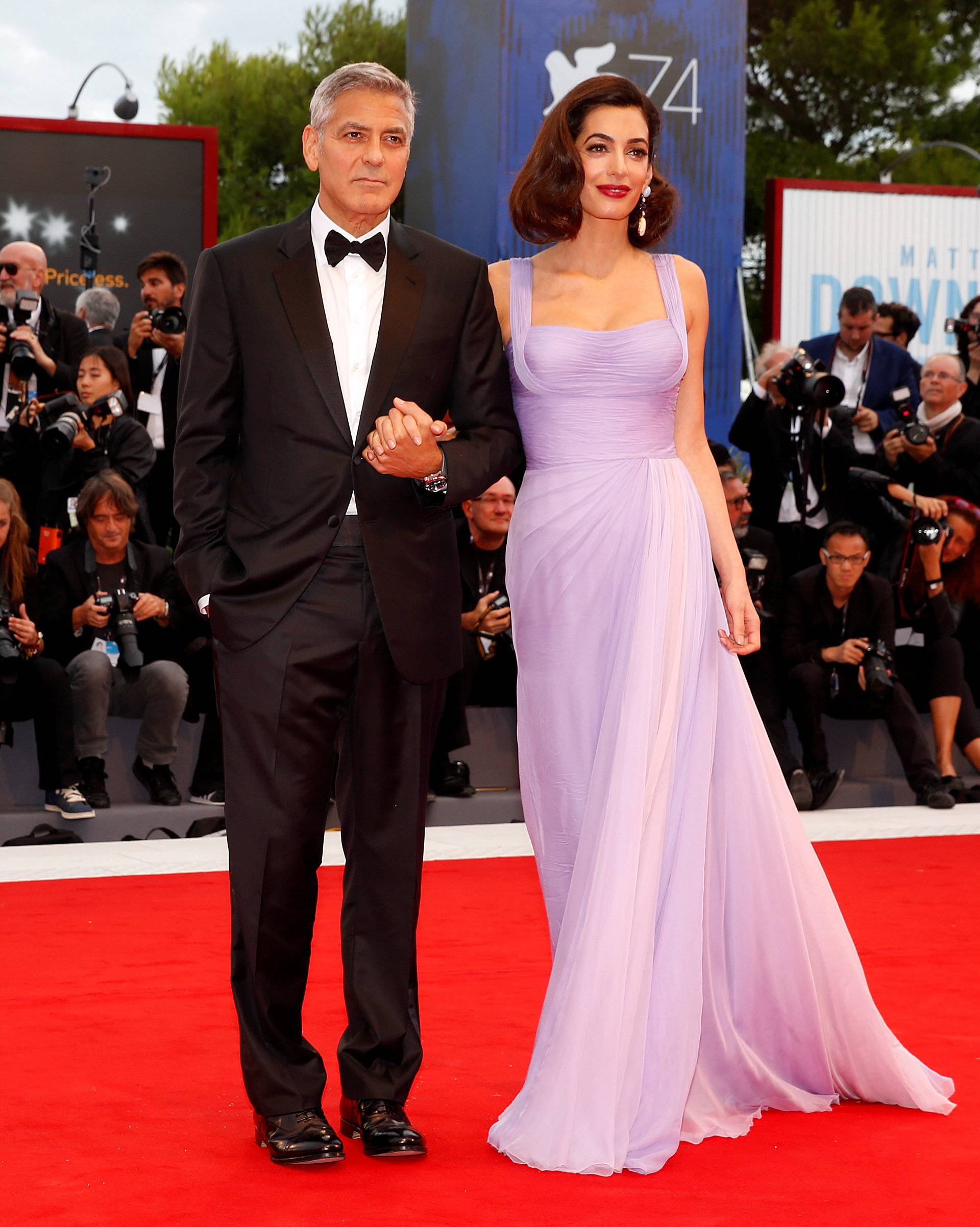 """Actor and director George Clooney and his wife Amal pose during a red carpet event for the movie """"Suburbicon"""" at the 74th Venice Film Festival in Venice, Italy"""
