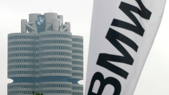 FILE PHOTO: A BMW flag is seen next to the BMW headquarter before the company's annual shareholders meeting in Munich
