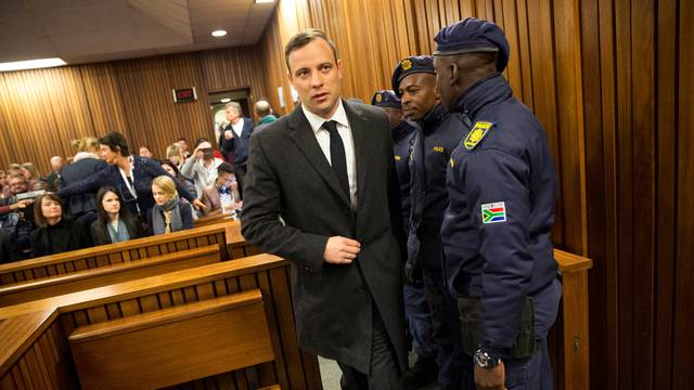 Olympic and Paralympic track star Oscar Pistorius arrives for sentencing at the North Gauteng High Court in Pretoria