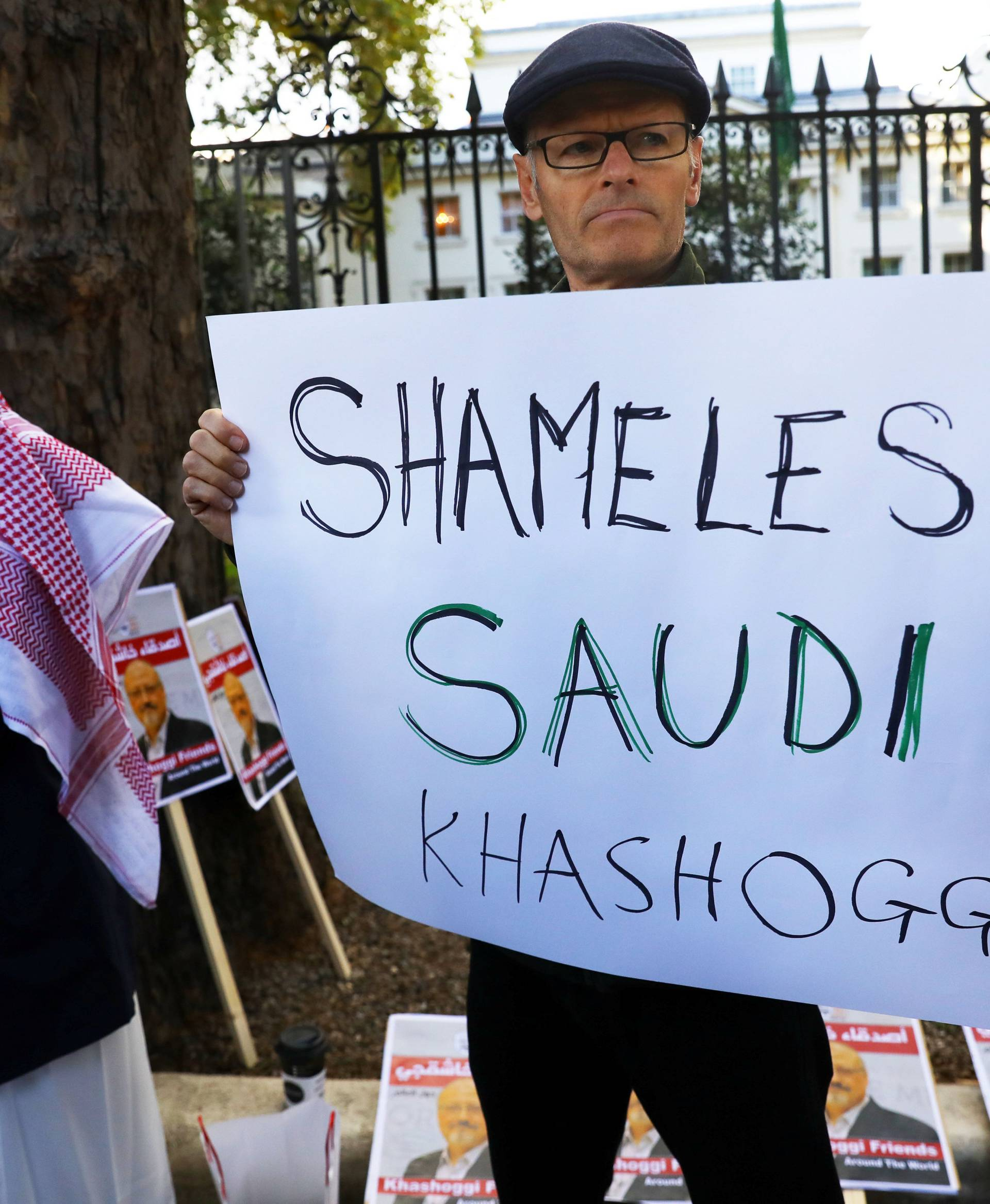 People protest against the killing of journalist Jamal Khashoggi in Turkey outside the Saudi Arabian Embassy in London
