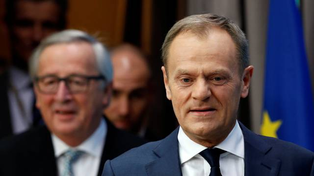 EU Council President Tusk and EU Commission President Juncker arrive to address a joint news conference during a EU leaders informal summit in Brussels