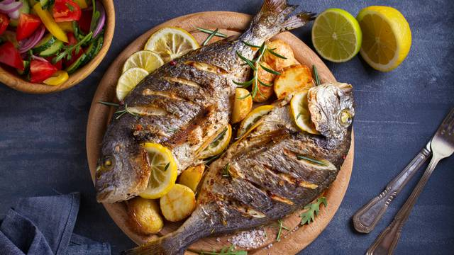 Roasted,Fish,And,Potatoes,,Served,On,Wooden,Tray.,Overhead,,Horizontal
